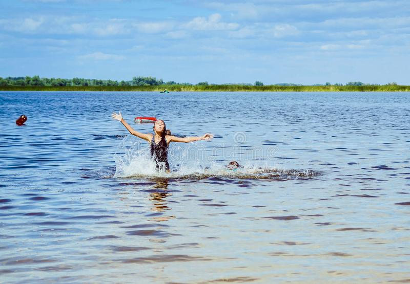 Children bathe in the river. The concept of a summer holiday. Children bathe in the river. The concept of a summer stock photo