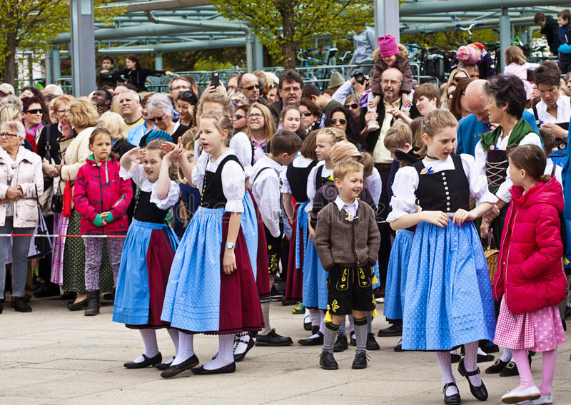 Children with Bavarian costumes. Garching, Germany - Boys and girls with the traditional Bavarian costumes wait the new may pole, to be erected in the main royalty free stock photography