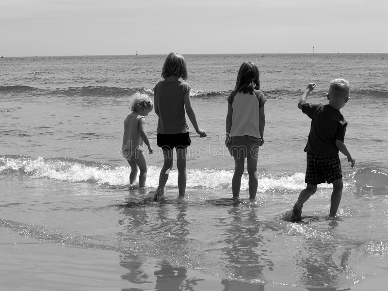 Children at the beach stock photos