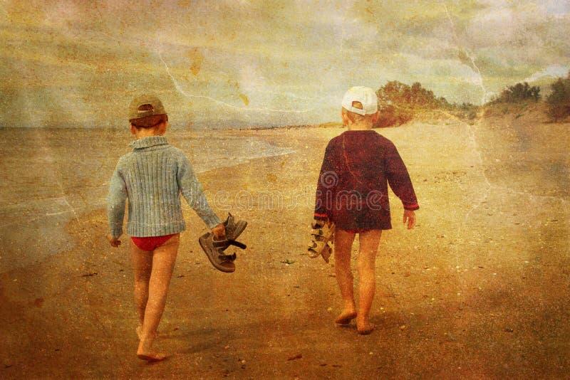 Children on the beach royalty free stock photo