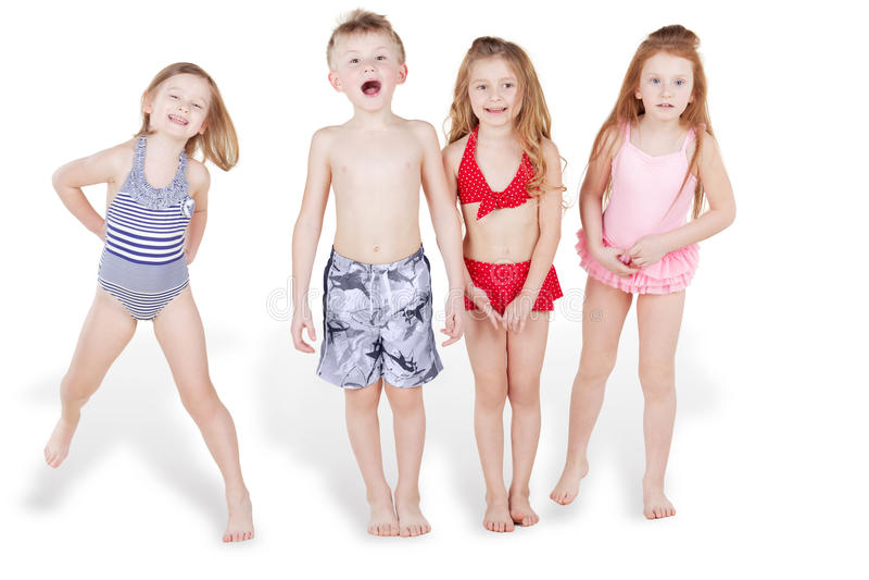 Children in beach suits have fun stock photos