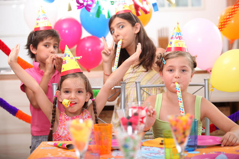Children at birthday party. Children at a birthday party royalty free stock photos