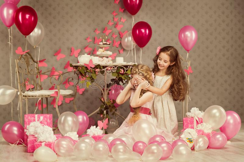 Children Birthday Party, Kid Girl Covering Eyes, Presents Balloons. Children Birthday Party, Kid Girl Covering Eyes, Decorated Retro Room with Presents and royalty free stock photo