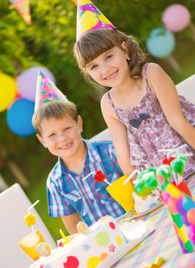Children birthday party. Modern birthday party with colorful cake at backyard stock photo