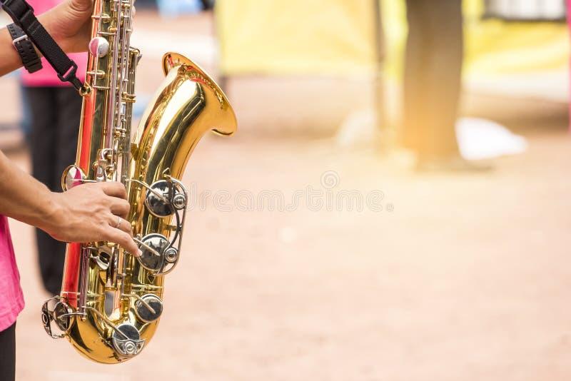 Children are blowing baritone Saxophone jazz music stock photos