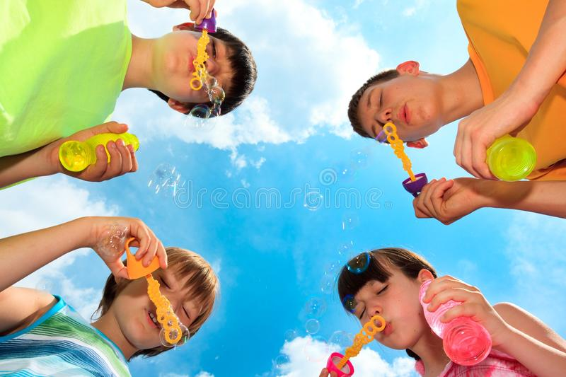 Children Blowing Bubbles Stock Photography
