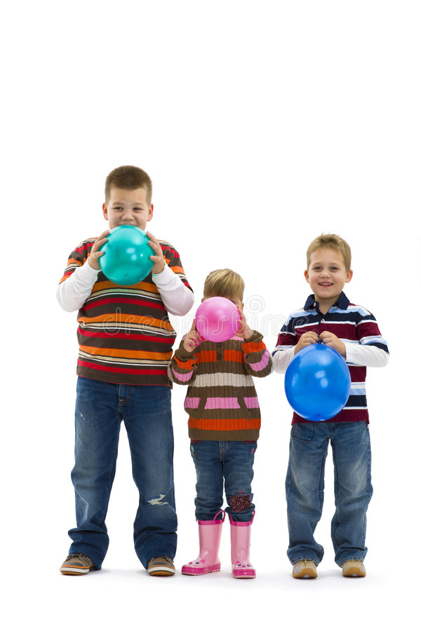 Children blowing up toy balloons stock photos