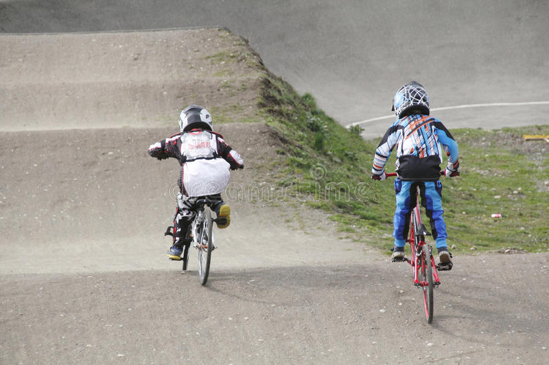 Children and BMX Competition. Children race their BMX bikes on a community track royalty free stock photos