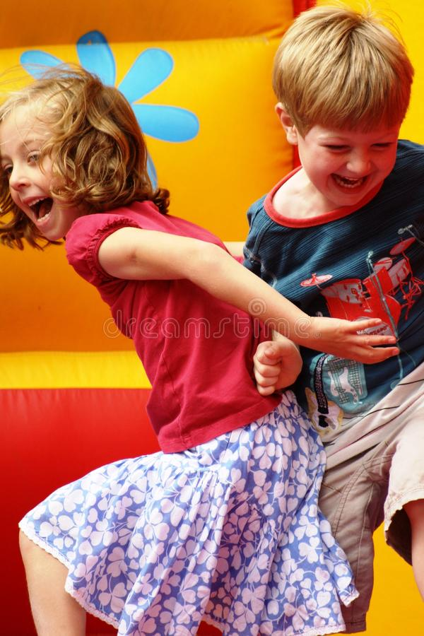 Children playing on a bouncy castle stock photos