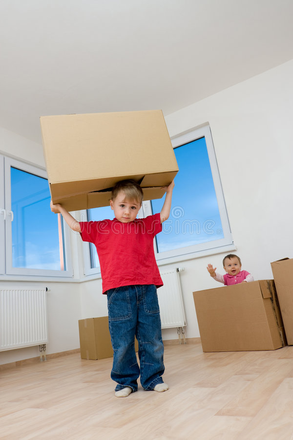 Children with boxes in home royalty free stock photography