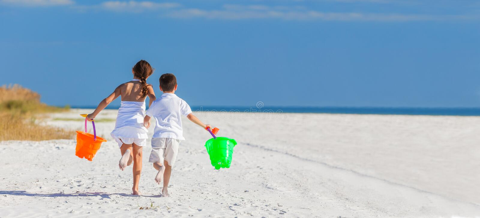 Children, Boy Girl Brother Sister Running Playing on Beach. Panoramic web banner happy children, boy girl, brother and sister running and having fun playing in royalty free stock photography