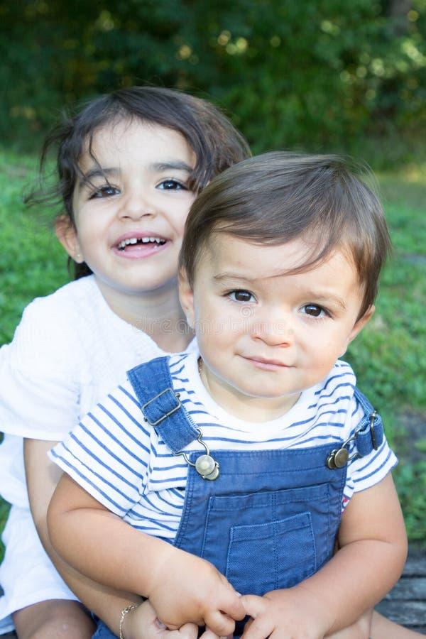 Children boy girl outdoor family sister brother concept. Two children boy girl outdoor family sister brother concept stock photo