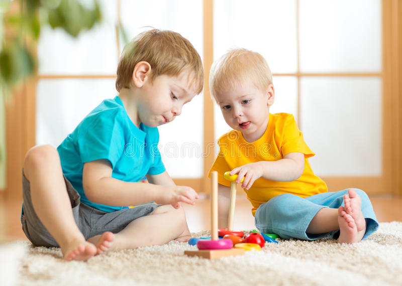 Children boys with toys in playroom. Children boys with educational toys in playroom stock photos