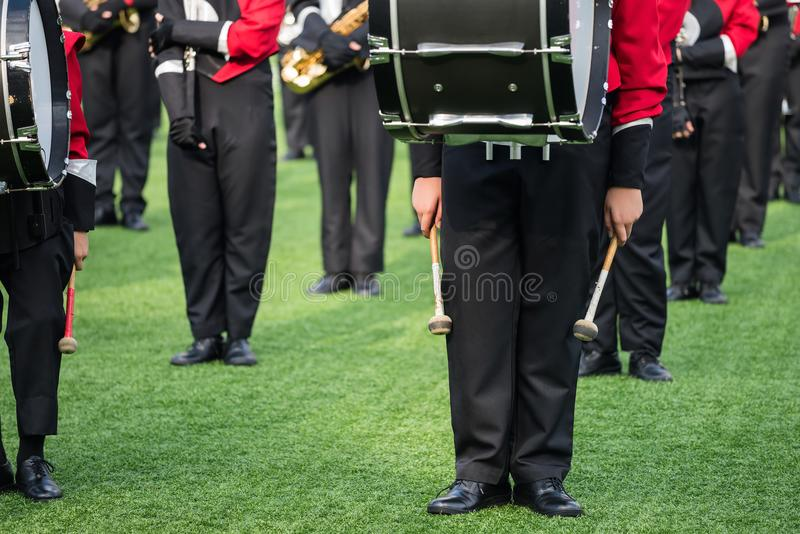 Children brass band in school. Closeup children brass band in school green field - closeup ensemble of musicians wait to play music for grand opening of sport royalty free stock photos