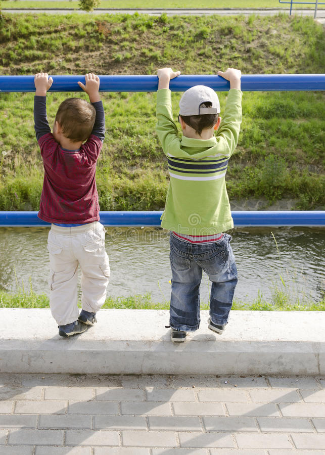 Children brothers playing royalty free stock image