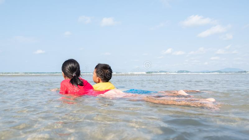 Children brothers and sisters enjoy the sea royalty free stock photo