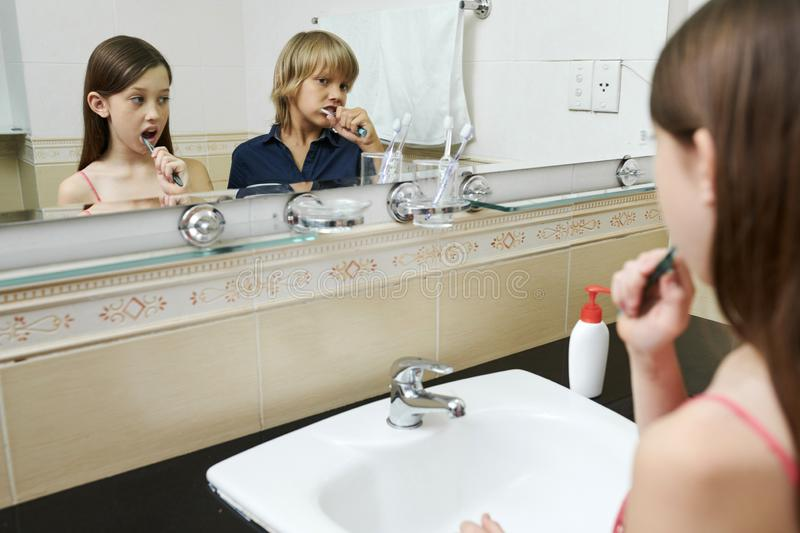 Children brushing teeth. In bathroom before going to sleep royalty free stock images