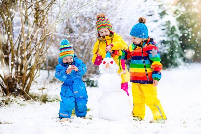 Kids Building Snowman. Children In Snow. Winter Fun. Stock ...