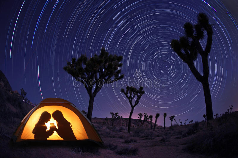 Children Camping at Night in a Tent. With Star Trails stock photography