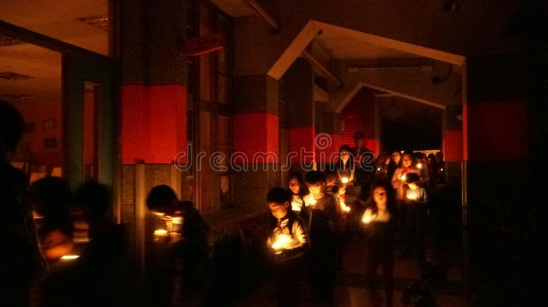 Children in candlelight ceremony stock photo