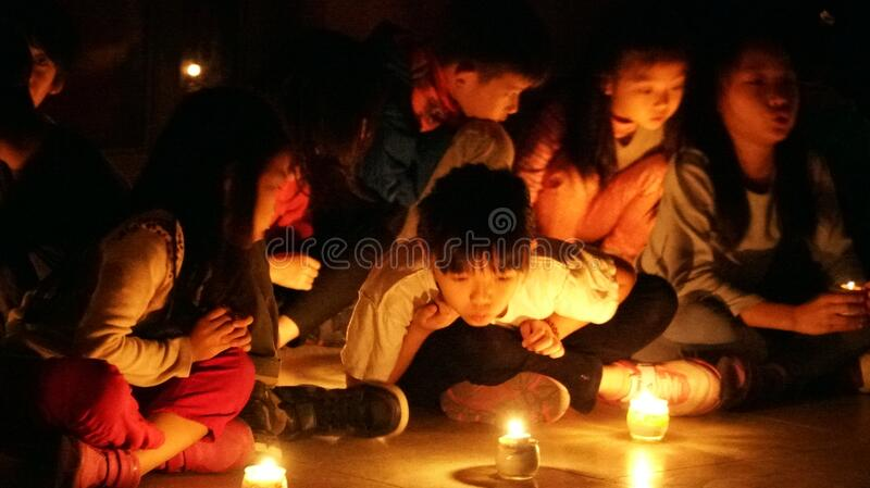 Children in candlelight royalty free stock images