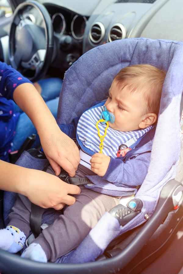 Children car chair. baby car seat for safety. Protection in the car. Cute boy in the child seat royalty free stock image
