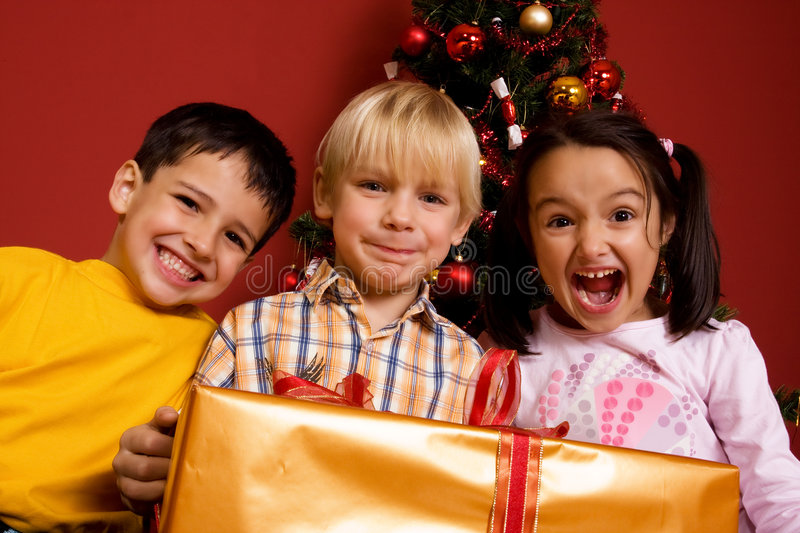 Download Children Carrying Christmas Gift Stock Photo - Image: 7150970