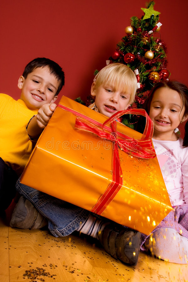 Download Children Carrying Christmas Gift Stock Image - Image: 7150997