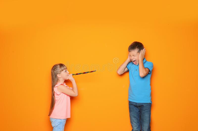 Children celebrating April Fool`s day. On color background stock images