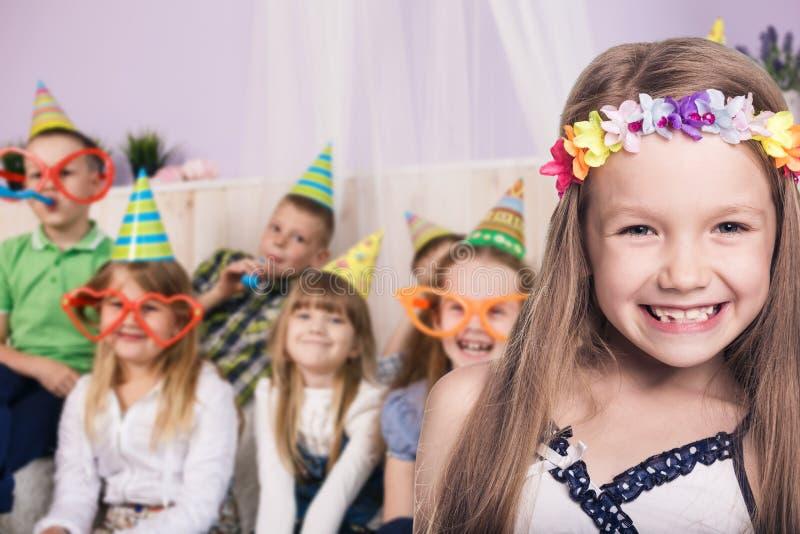 Children celebrating birthday stock image