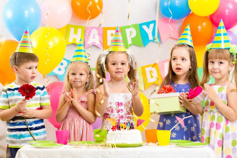 Children celebrating birthday holiday stock photo