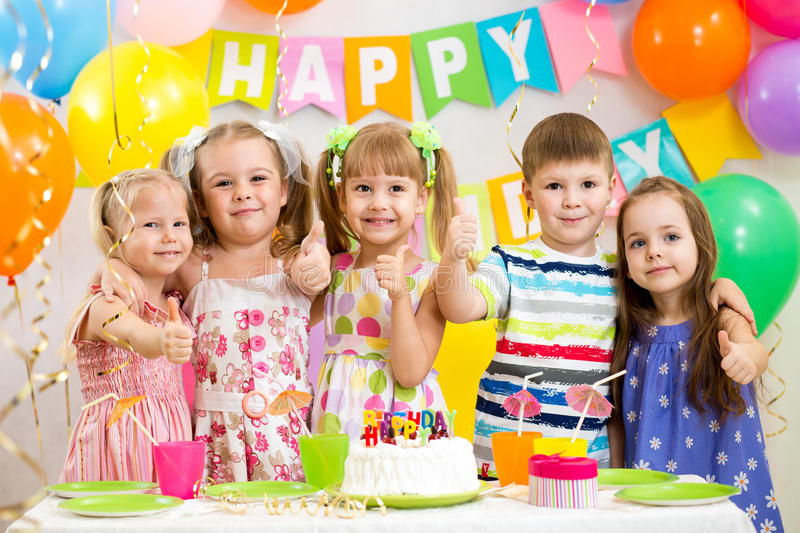 Children celebrating birthday party stock photos