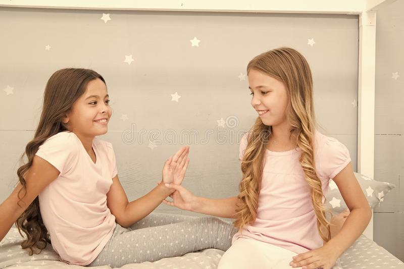 Children cheerful play bedroom. Great start of day. Happy childhood moments. Joy and happiness. Happy together. Kids stock photography