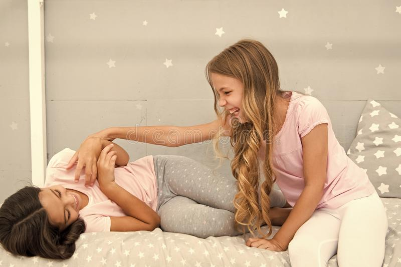 Children cheerful play bedroom. Happy childhood moments. Joy and happiness. Happy together. Kids girls sisters best stock photography
