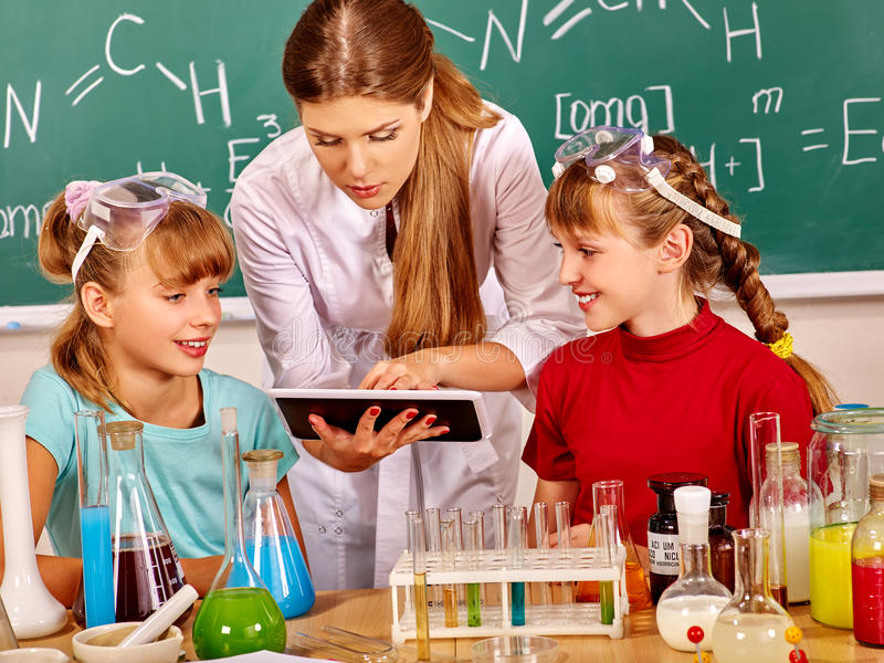 Children in chemistry class. royalty free stock image