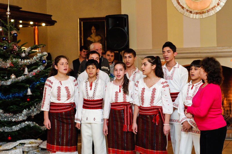 Children choir singing romanian carols stock image