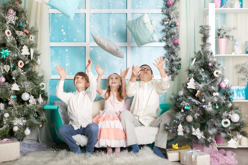 Children in a Christmas decorations royalty free stock image