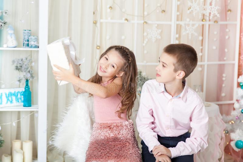 Children in a Christmas decorations stock photos