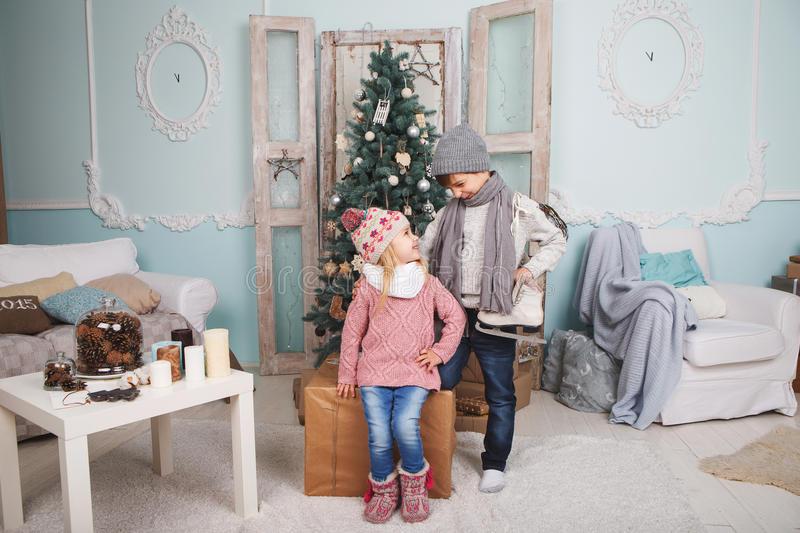 Children and Christmas tree royalty free stock image