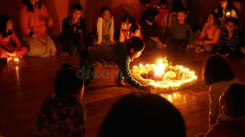 Children in circle around candles stock images