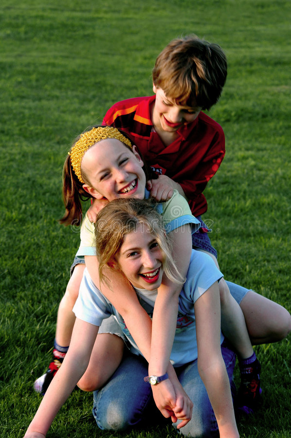 Children climbing on each other in park. Lifestyle group portrait of children, nikon D70 stock images