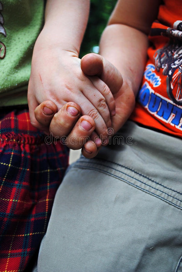 Children cling to the arms. royalty free stock photo
