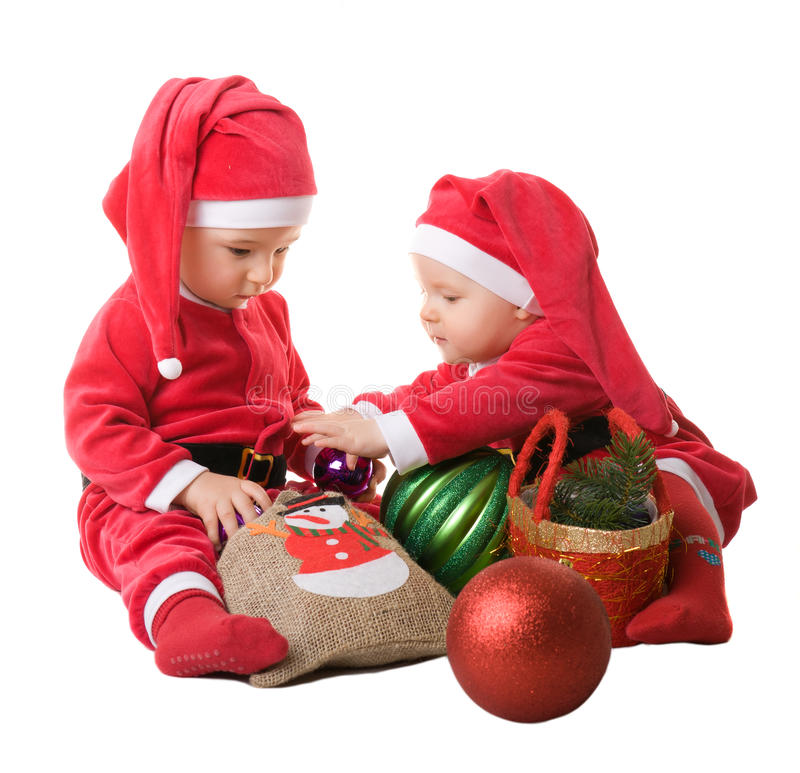 Children in the clothes of Santa Claus stock photo