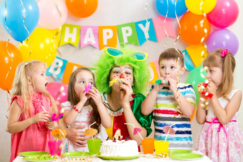 Children and clown at birthday party royalty free stock photo
