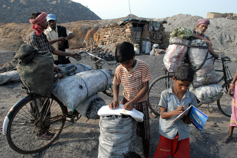 Children At The Coalfield Area. In Jharia many children work in the coal industry as pickers to earn money for their families. The children do not go to school stock images