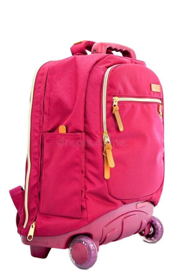 Children& x27; color rojo del bolso de la carretilla de la escuela de s fotografía de archivo