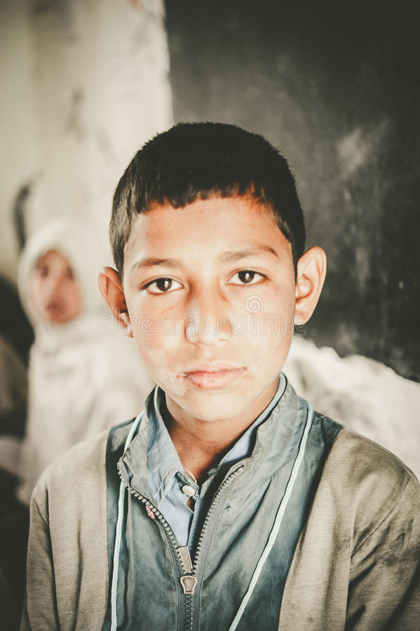 Children coming to School in Skardu, Pakistan. Skardu, Pakistan - April 17, 2015 Children in a village in the south of Skardu are learning in the classroom of royalty free stock image