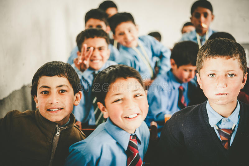 Children coming to School in Skardu, Pakistan. April 17, 2015 Children in a village in the south of Skardu are learning in the classroom of the village school stock images