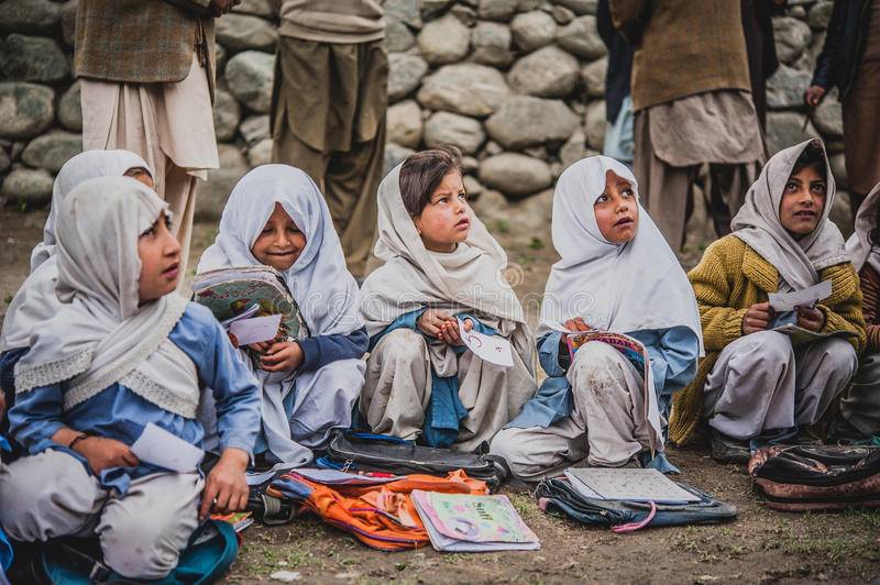 Children coming to School in Skardu, Pakistan. April 17, 2015 Children in a village in the south of Skardu are learning in the classroom of the village school royalty free stock photo