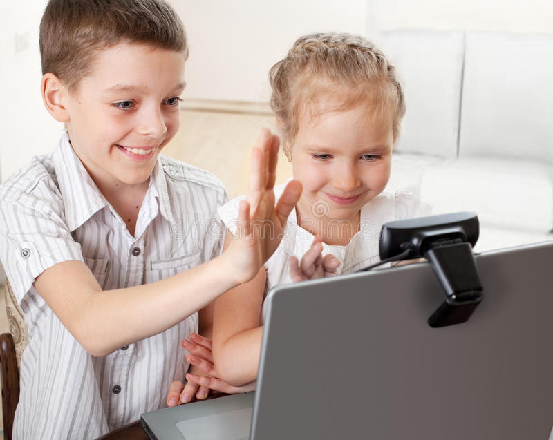 Children communicate with online royalty free stock photo